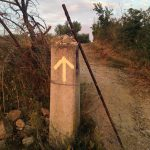 yellow arrow, walking stick, Camino