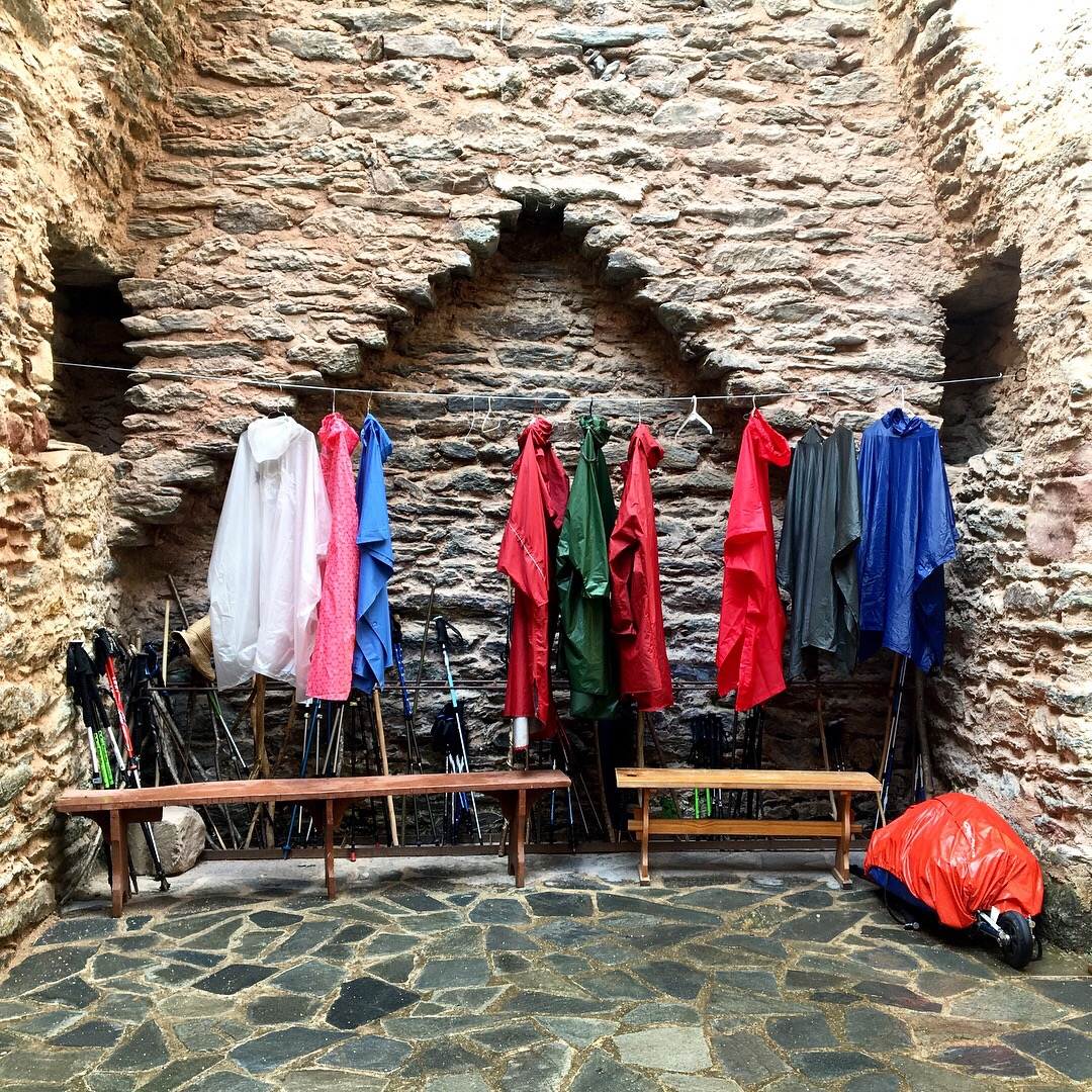 Line of raincoats, Day 10 on the Chemin du Puy, Conques