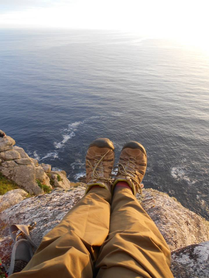 Sitting on the rocks in Finisterre, Camino de Santiago