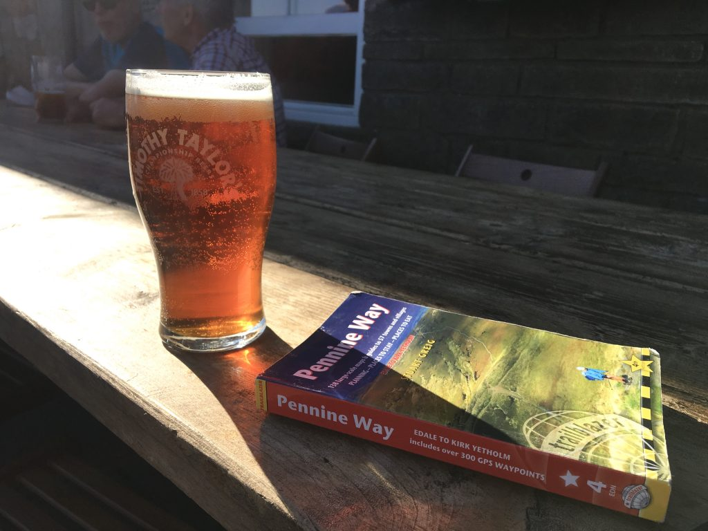 Pennine Way guidebook and beer at the Tan Hill Inn, Pennine Way