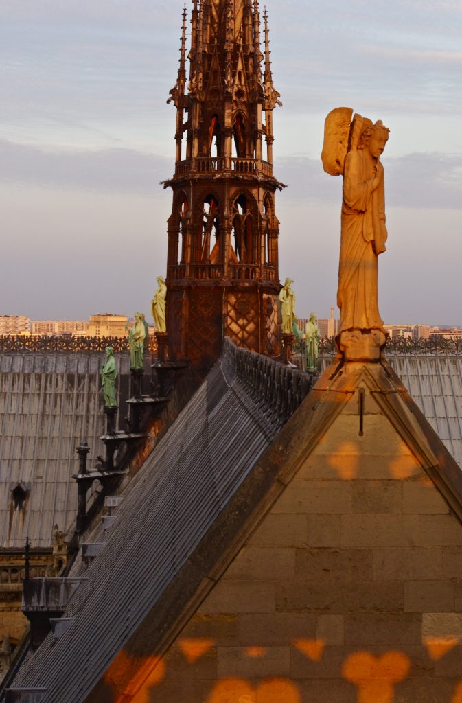 Sun setting on spire of Notre-Dame, Paris, France