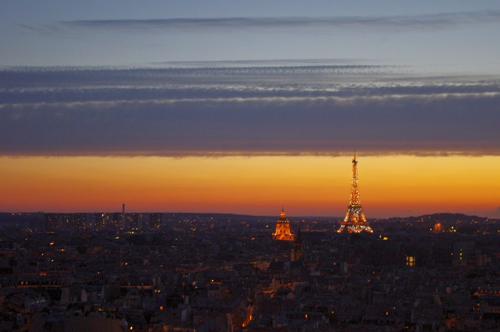 Sparkling Eiffel Tower at sunset, view from the towers of Notre Dame, Paris, France