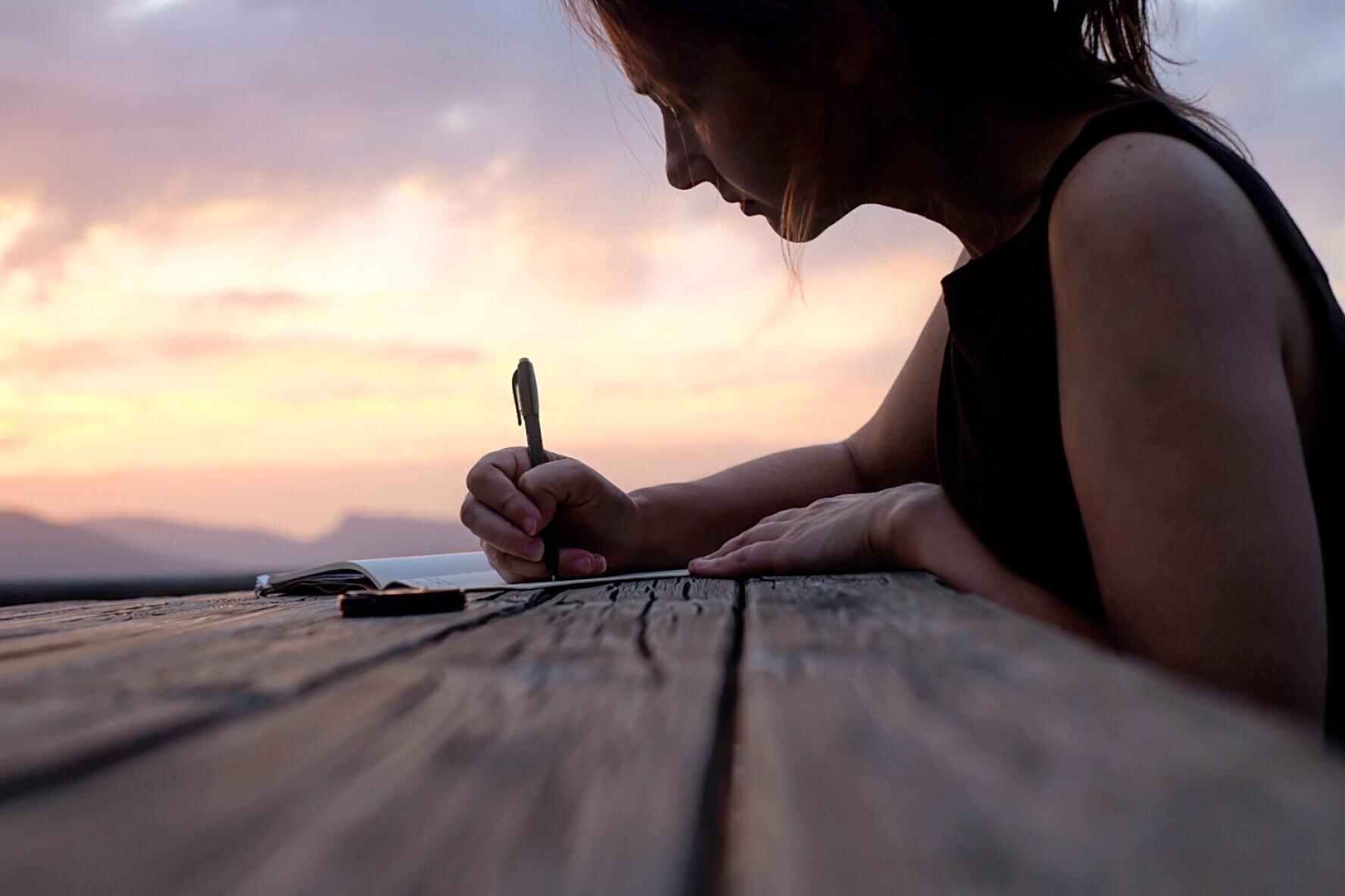 journal writing on Camino Aragones, Arres, sunset