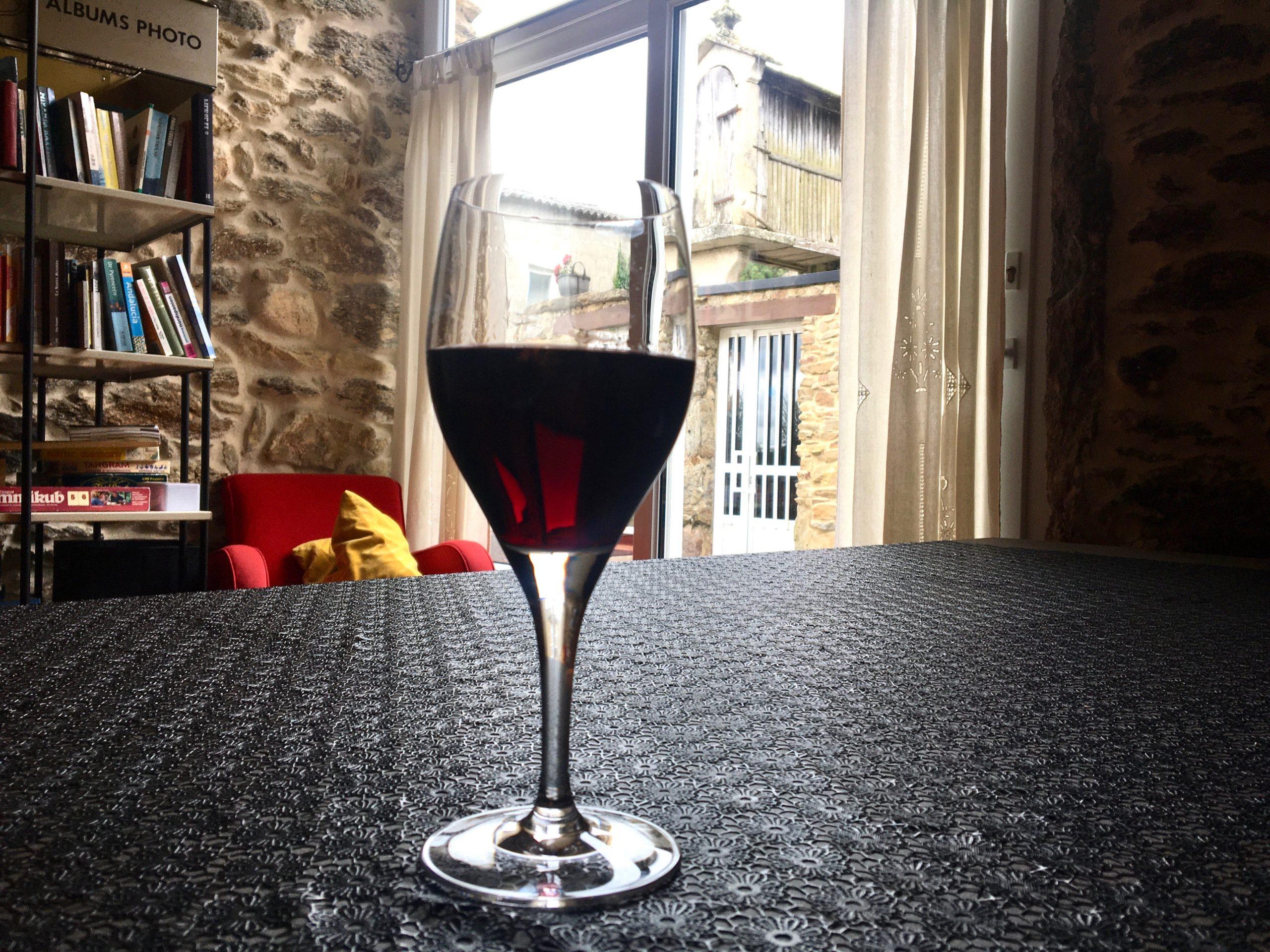 Glass of wine in Albergue Ponte Ferreira, Camino Primitivo